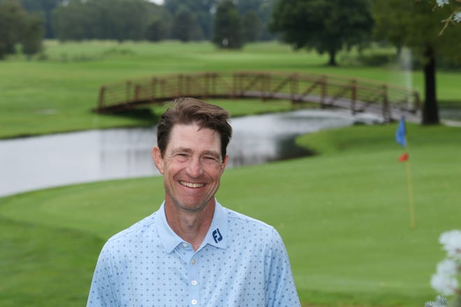 Doug Davis, the PGA professional at River Greens Golf Course, is seen near the course's iconic 27th hole.