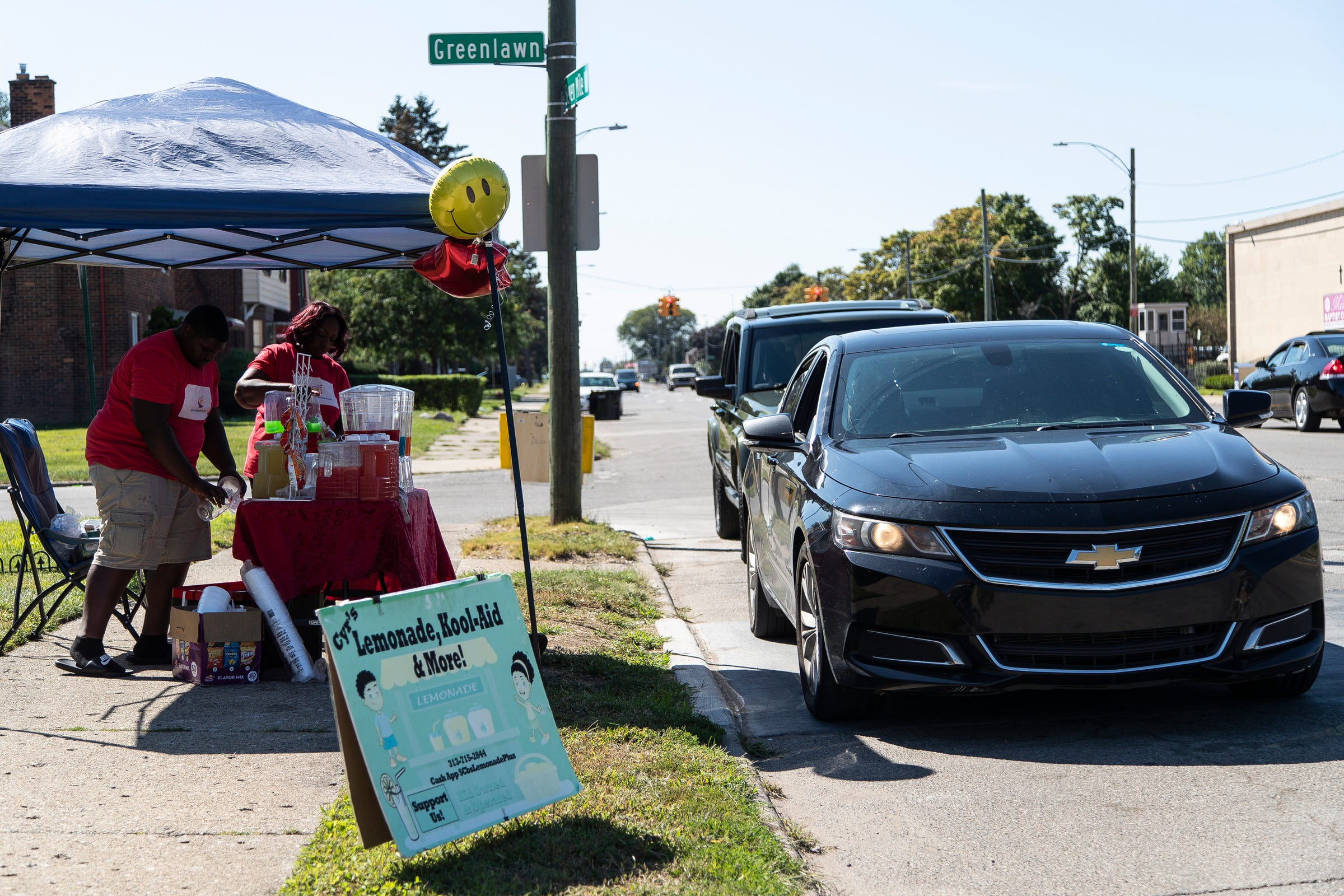 Cyr-Edward Shearon, 14, and his mother, Laverne Naize prepare orders for customers at CB's Lemonade Plus on Seven Mile Road in Detroit on Sept. 2, 2021.