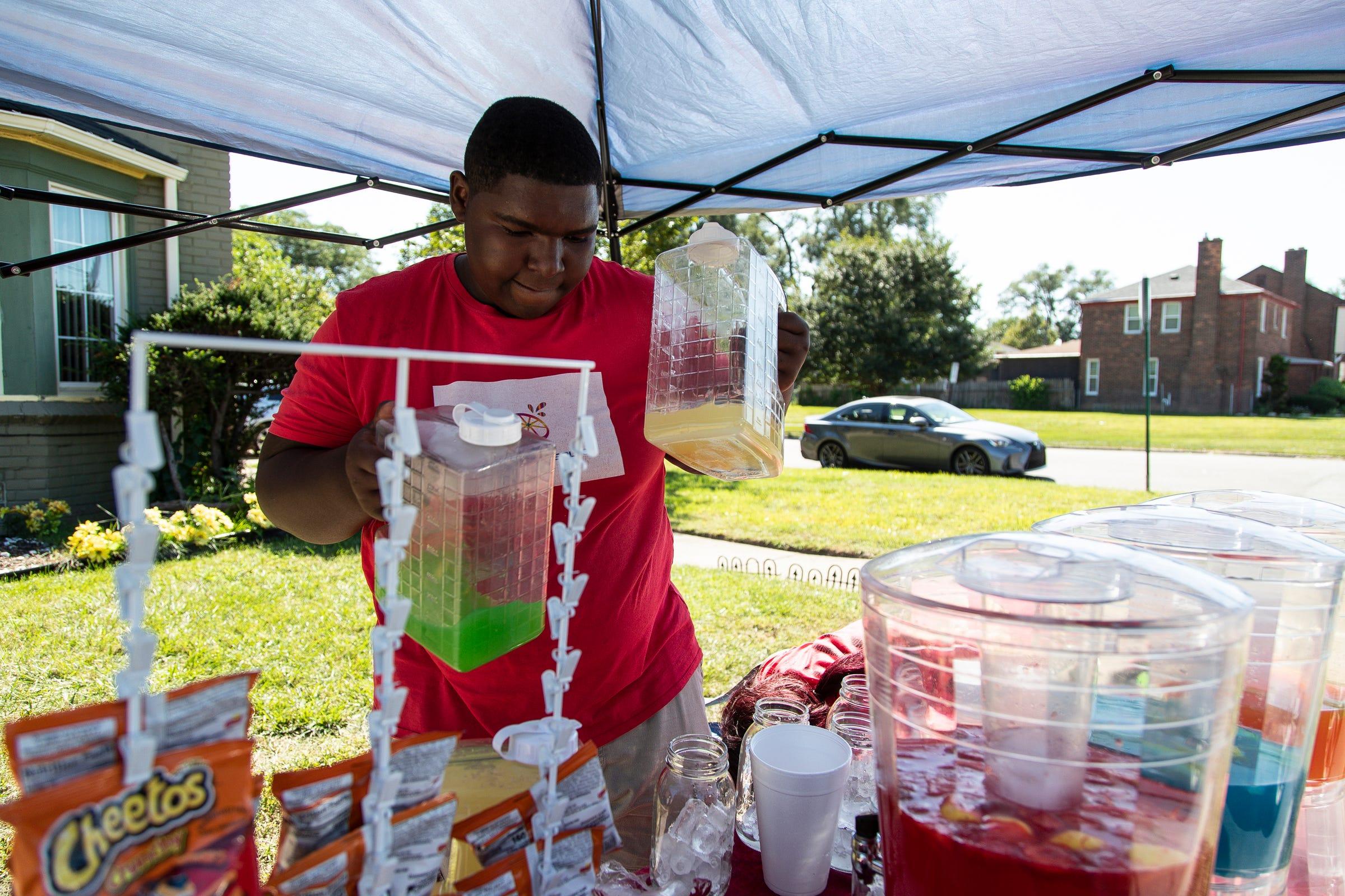 Cyr-Edward Shearon, 14, prepares an order at CB's Lemonade Plus on Seven Mile Road in Detroit on Sept. 2, 2021.