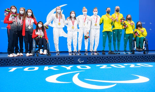 From left, silver medalists Anastasiia Gontar, Elizaveta Sidorenko, Viktoriia Ishchiulova and Ani Palian, of Russian Paralympic Committee, gold medalists Hannah Aspden, Mikaela Jenkins, Jessica Long and Morgan Stickney, of the United States, and bronze medalists Ellie Cole, Keira Stephens, Emily Beecroft and Isabella Vincent, of Australia, pose on the podium during the awarding ceremony for the women's 4x100m medley relay swimming final at the Tokyo 2020 Paralympic Games at Tokyo Aquatics Centre in Tokyo, Japan. Ilya Pitalev / Sputnik  via AP