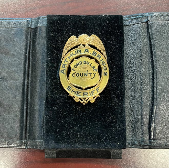 The badge of Arthur A. Briggs, Fond du Lac County's 39th sheriff, was found in a desk drawer at a former bank in Oshkosh. It has been returned to Fond du Lac County Sheriff Ryan Waldschmidt.