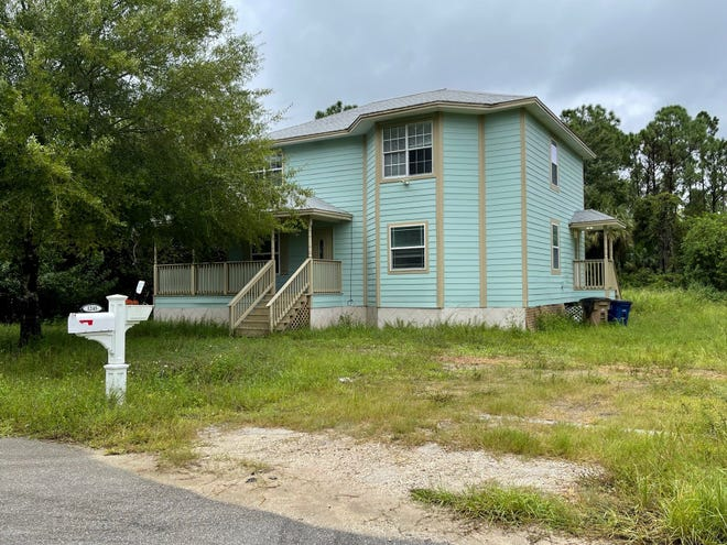 A  Lehigh Acres home listed as the residence of a couple named in a federal fraud indictment Thursday appeared abandoned and neglected. A lockbox was affixed to the front door.