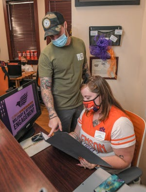 Tia Jones, Student Assistant for Military & Veteran Engagement at Clemson University, works with veteran Griffin Stephens, former specialist in the U.S. Army studying in Clemson, in Vickery Hall in Clemson Thursday, September 2, 2021.