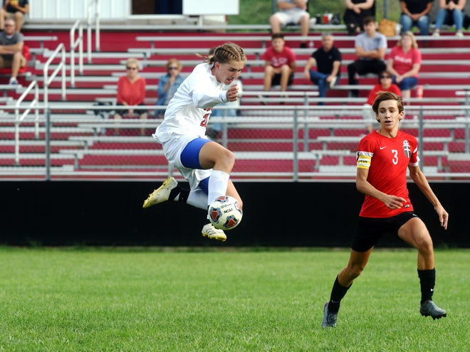 Liberty Union senior Jon Wheeler leaps to control the ball during a 2-1 win against Rosecrans on Wednesday night at Mattingly Family Field.