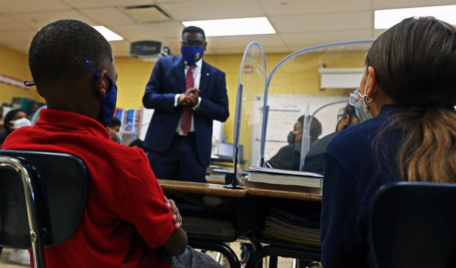 Dr.Keith P. Posley, center, Superintendent of Milwaukee Public Schools drops in on a class at Rogers Street Academy on the first day of school.