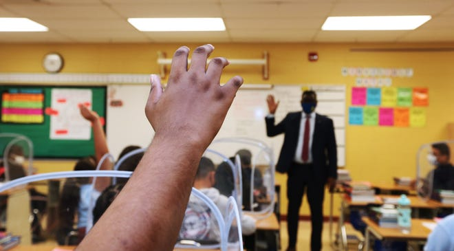 A student raises his hand during a visit by Dr. Keith P. Posley, superintendent of Milwaukee Public Schools at Rogers Street Academy in September. Posley says MPS doesn't teach critical race theory but does use programming developed by the Black Lives Matter movement.