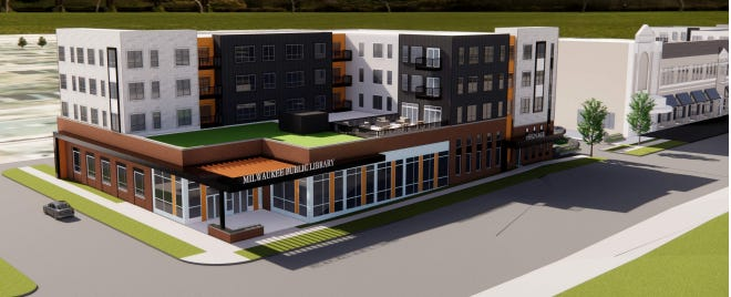 A revised plan for a new King Library branch and apartments also calls for redeveloping part of the former Garfield Theatre (right).