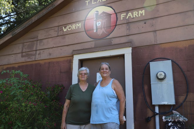 Sandy (left) and Charlene (right) Yates pose for a photo at T Lazy T Worm Farm. The Yates family opened the farm in 2010.