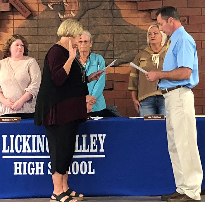 Jo Lynn Torbert, longtime treasurer for Licking Valley Local Schools, was sworn in by superintendent Dave Hile as the district's newest school board member at a special board of education meeting on Wednesday.