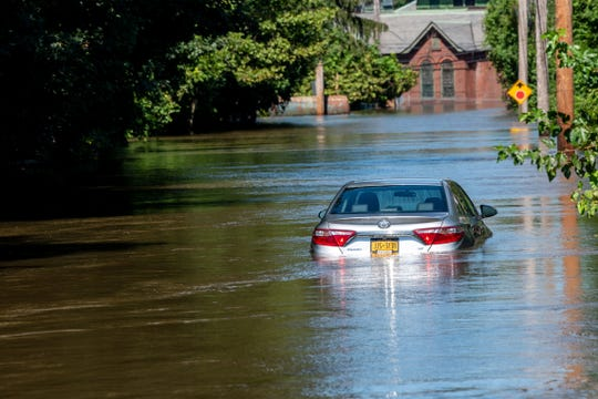 A flooded car on Milford Avenue in New Milford on Thursday after Ida struck.