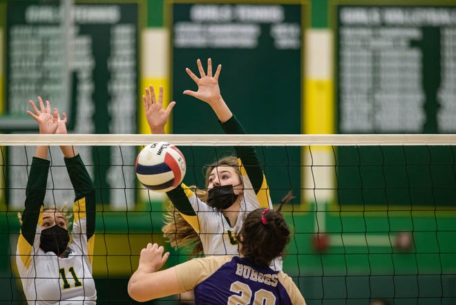 Ava Kincaid (11) and Maggie  Lightheart (6) go up for a block as the Mayfield Trojans face off against the Burges Mustangs at Mayfield High School in Las Cruces on Tuesday, Aug. 31, 2021.