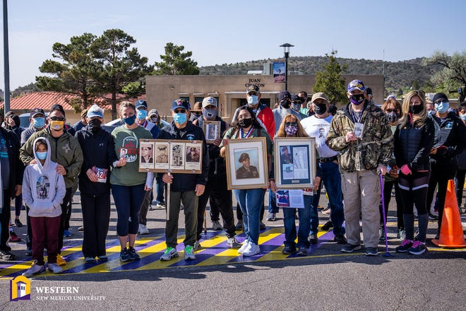 Veterans and civilians at the inaugural Western New Mexico University Remembrance March, held on campus where a memorial will be held on the 20th anniversary of the 9/11 attacks.