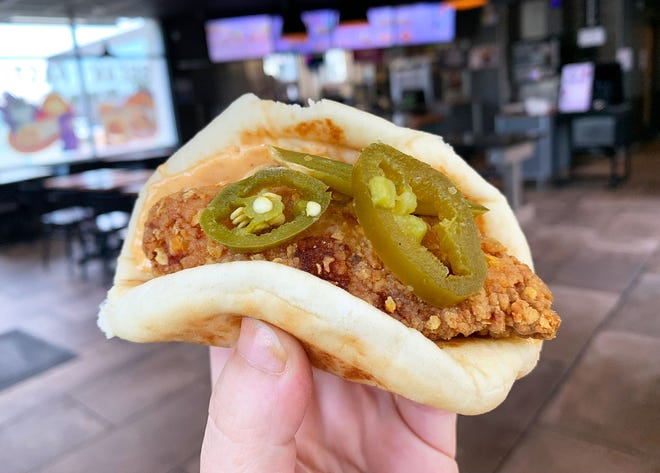 Taco Bell's Crispy Chicken Sandwich Taco comes in a regular and spicy version with jalapeños.