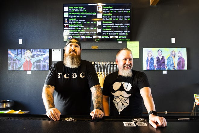 From left are owners Justin Egbert and Paul Power behind the bar at TCBC Brewing Company in Litchfield Park, Ariz., on Sept. 1, 2021.