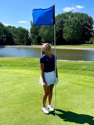 Port Huron Northern senior Maddy Hemby celebrates sinking a hole-in-one during a Macomb Area Conference-Red dual on Wednesday, Sept. 1, 2021, at Sycamore Hills in Macomb.