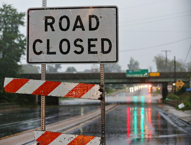 A sign warns that the intersection of East Market Street at North Hills Road is closed as rain continues to fall Wednesday, Sept. 1, 2021. Between 3-4 inches of rain was predicted for York County, as a result of Hurricane Ida, by the National Weather Service in State College. Dawn J. Sagert photo