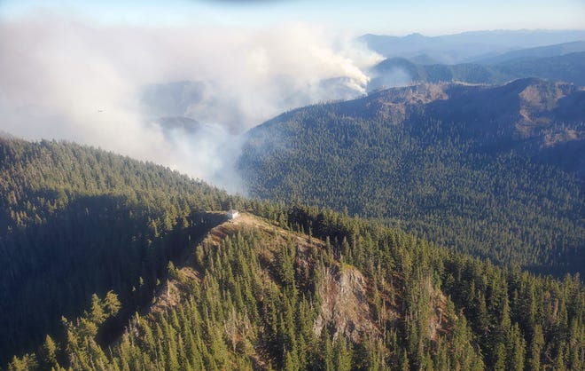Smoke rises over the Bull Complex fire burning near the Bull of the Woods Lookout in the Cascades Range.