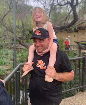 First-year Robert Lee head coach Adam Cline with his daughter Brynlee