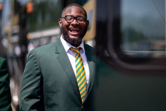 FAMU offensive lineman Jalen Brayboy is all smiles as he boards the bus for Tallahassee International Airport and a flight to South Florida on Thursday, Sept. 2, 2021. The Rattlers face Jackson State in the Orange Blossom Classic on Sept. 5 at Hard Rock Stadium in Miami Gardens.