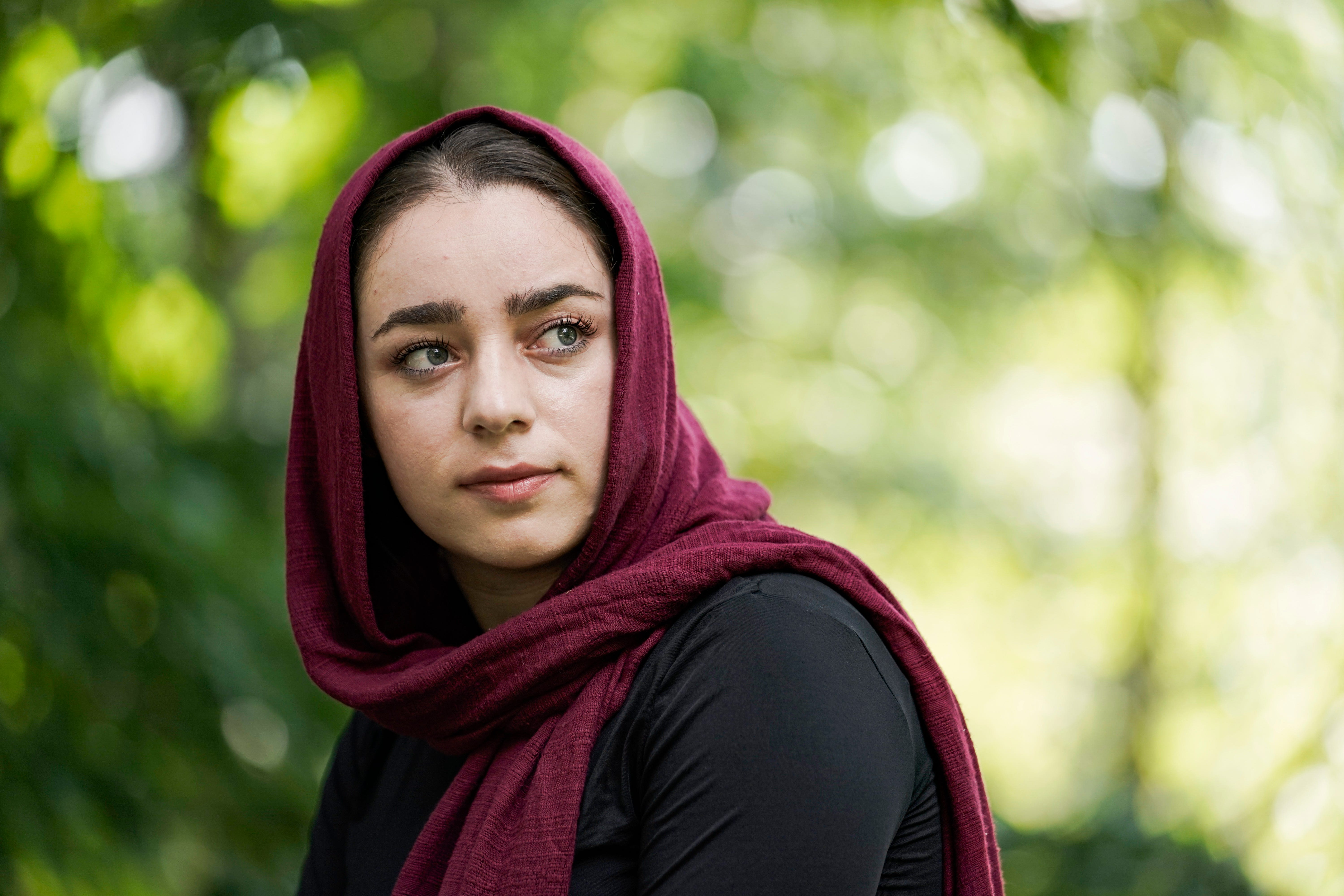Aug 25, 2021; Charlottesville, Virginia, United States; August 25, 2021; Charlottesville, Va.  Zainora Babayee, 23, grew up not knowing what the terrorist attacks on September 11th were. Babayee grew up in U.S. occupied  Afghanistan before immigrating to the United States with her parents and 6 siblings five years ago after her father worked as a private contractor with the U.S. military. She says she really only came to understand what happened on 9/11 once she moved to the United States. Babayee is now a student at University of Virginia in Charlottesville, studying government.