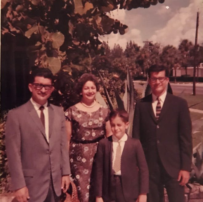 A family photo of Adrianna Cuevas shows the author's grandfather, from left, his grandmother, his Uncle Armando and his father in Miami.  His grandfather and uncle joined his father a year after arriving in Miami from Cuba.  Her grandmother joined a year later.