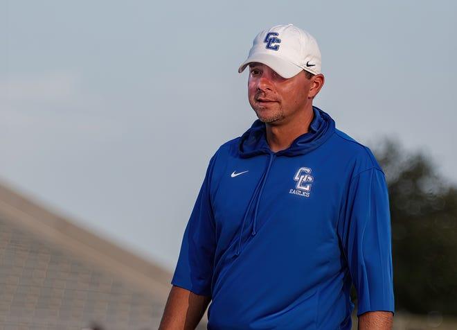 Cedar Creek head coach Josh Thomas looks at his squad before his team's game versus Akins on Sept. 2.