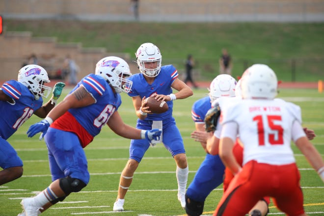 Aiden Perrott collects the deep snap for Leander in non-district action against Vista Ridge Sept. 2 at Bible Stadium. Vista Ridge came back late to defeat Leander by a final score of 23-21.
