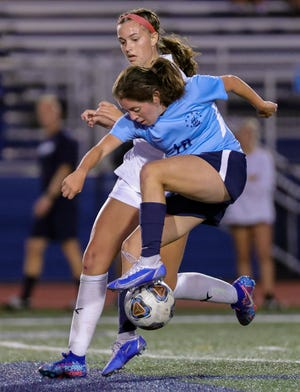 Hudson's Delaney Halsted and Twinsburg's Brenna Utrup battle for the ball during the Tigers' 1-0 win at Hudson Wednesday