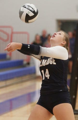 Tallmadge Zoe Rensel bumps the ball against Revere during the volleyball match at Revere High School on Thursday, Sept. 2, 2021, in Richfield.   [Mike Cardew/Akron Beacon Journal]