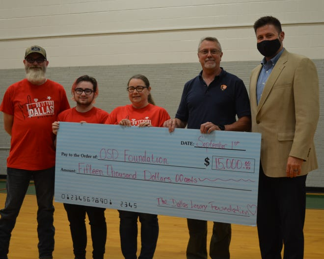The Lowry family's donation to the Oklahoma School for the Deaf Foundation will fund the annual Dallas Lowry Fighting Heart Award in honor of their son and brother (from left): Father Scott Lowry, brother Kale Lowry, mother Lacy Lowry, OSD Foundation member Bill Wright and OSD Superintendent Chris Dvorak.