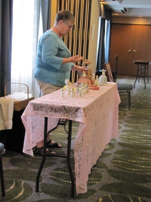 Ashland BPW member Cheryl Fulk presents information about half dolls while speaking at the Business and Professional Women of Ohio's summer board meeting at the Ashland Holiday Inn Express.