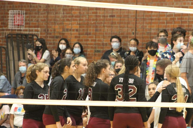 The Davidson Fine Arts volleyball team huddles during a timeout in a match against Cross Creek on Thursday, Sept. 2. In just its third year of competition, Davidson is looking for a second-straight region title.