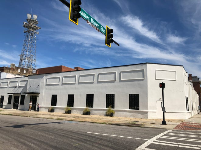 The former SharedSpace building at the corner of Greene Street and James Brown Boulevard awaits new signage as 901 Greene Street, the rebranded iteration of the coworking office space company.