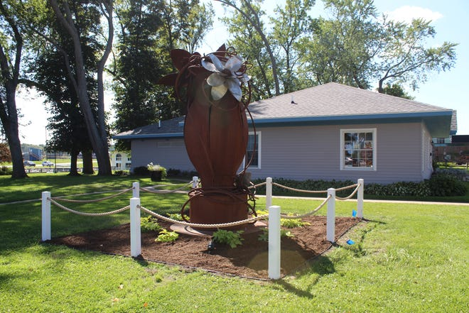 Urn-E, a sculpture made by Cheboygan artist Ann Gildner, was donated to the City of Cheboygan several months ago. The artwork moved from the Cheboygan Cement Products plant recently to its new home on the north lawn of the Cheboygan Area Chamber of Commerce.