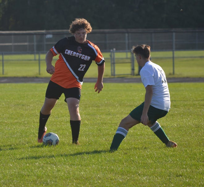 Cheboygan senior defender Scott Pavwoski, left, possesses the ball in front of a Grayling player during the second half of a varsity boys soccer contest in Cheboygan on Thursday, Sept. 2.