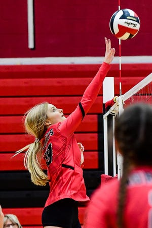 Junior middle hitter Anna Fisher of the 2021 Chillicothe High School volleyball Lady Hornets sends a shot over the net during CHS' home opener against Trenton Thursday, Sept. 2. Fisher shared the team lead in kills with two and service aces with seven as Chillicothe won in straight games.