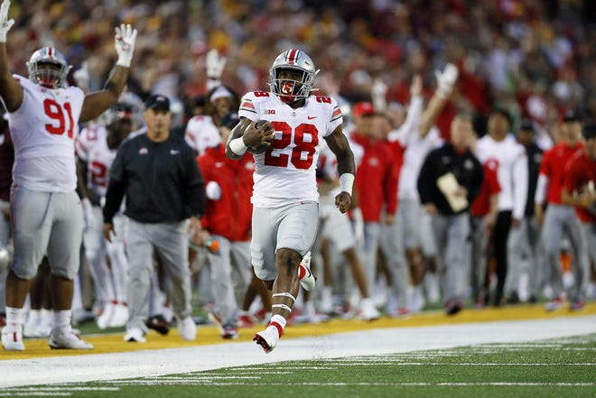 Ohio State Buckeyes running back Miyan Williams (28) scores a rushing touchdown against Minnesota Golden Gophers during the first quarter of their game in Huntington Bank Stadium at University of Minnesota in Minneapolis, MN on September 2, 2021.