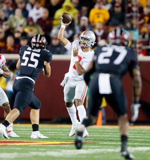 """After a shaky first half, C.J. Stroud completed 5 of 8 passes for 236 yards and four touchdowns after halftime. """"I didn't do terrible, but not the best I could,"""" he said."""