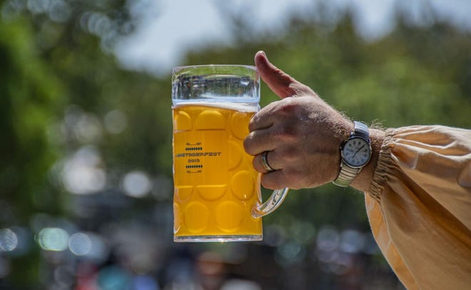 Joel McClosky of Four Saints Brewing Company holds a glass of beer at the 2019 Ashetoberfest. Asheboro's fifth annual Ashetoberfest will be held on Saturday.