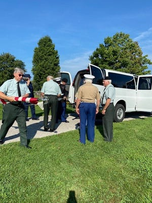 Members of the 555th Honors Detachment remove items from their van to prepare for a service at the Maple Mound Cemetery in Creston on Aug. 28.