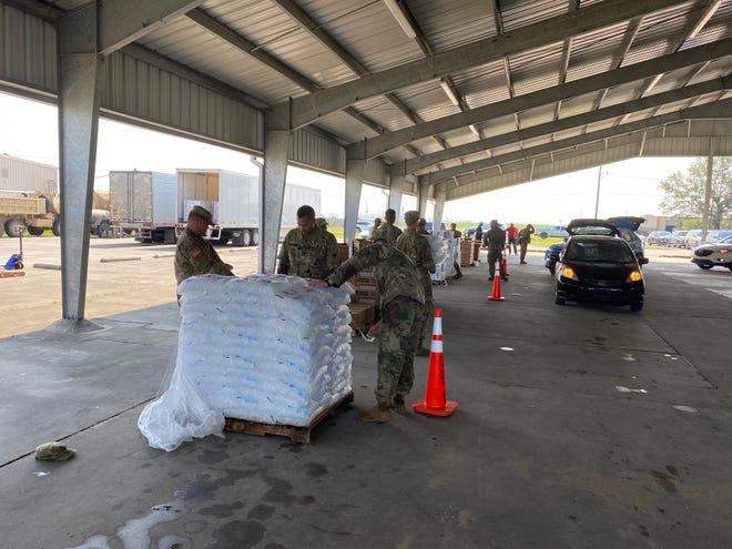 The City of Donaldsonville, Ascension Parish Government, GOHSEP, and the Louisiana National Guard partnered to offer tarps, water, ice, and Meals Ready to Eat (MREs) free to those in need.