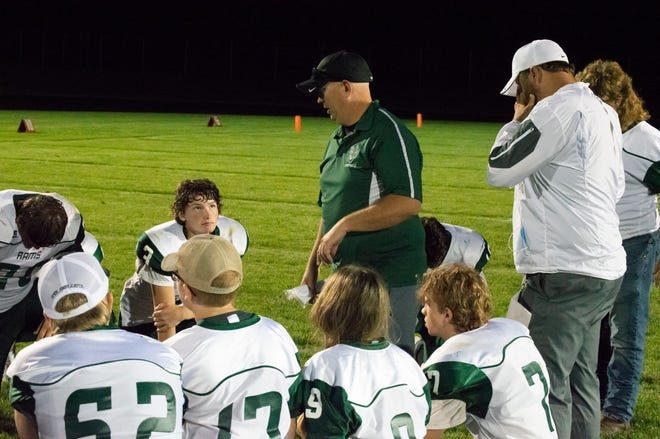 Coach Price talks to the team after their 60-0 loss to Vestaburg.