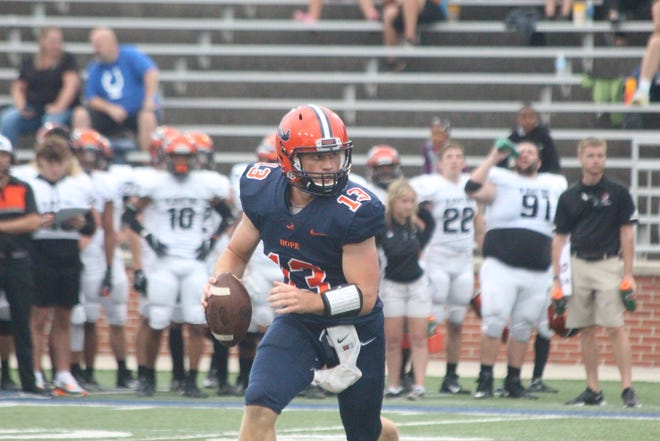 Hope College QB Chase Brown rolls out during the Flying Dutchmen's win over Anderson University