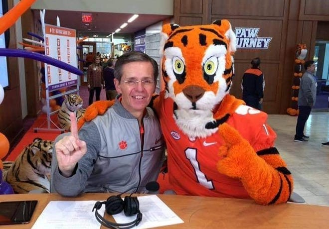 The Vloice of the Tigers Don Munson poses with the Tigers mascot during a recent event at Clemson, S.C.