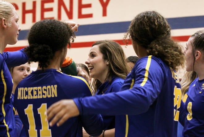 Nickerson head volleyball coach Payton Scheer talks to her players after they defeated Cheney 26-24, 25-22 at Cheney High School, her alma mater.