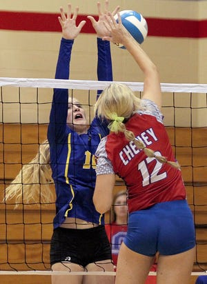 Nickerson's Ava Jones (10) blocks the spike of Cheney's Lacy Luehrs (12) during their game Thursday afternoon at Cheney. Nickerson defeated Cheney 26-24, 25-22.