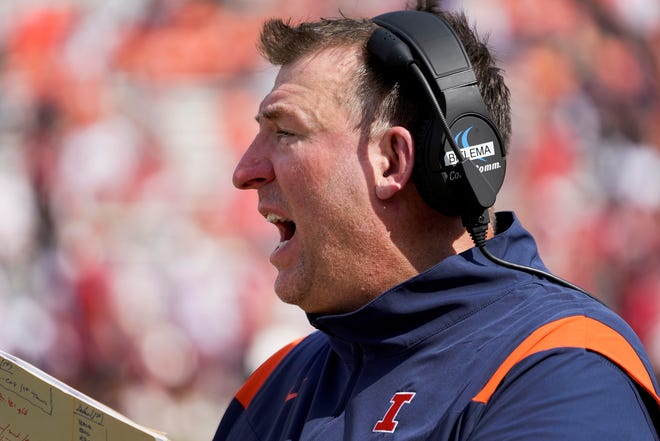 Illinois head coach Bret Bielema yells out onto the field during the second half of an NCAA college football game against Nebraska Saturday, Aug. 28, 2021, in Champaign. Illinois won in 30-22 in Bielema's debut as head coach.