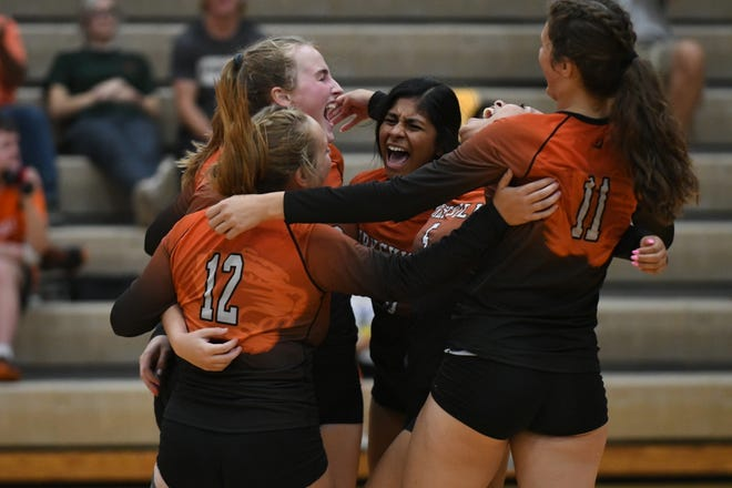 The Kirksville volleyball team cheers after finishing the third set Thursday to beat Mexico 3-0.