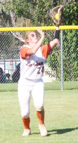 La Junta High School's Jaylin Springer makes the catch in left field in the Tigers' 9-8 come from behind victory over Lamar Thursday at Tippy Martinez Park.