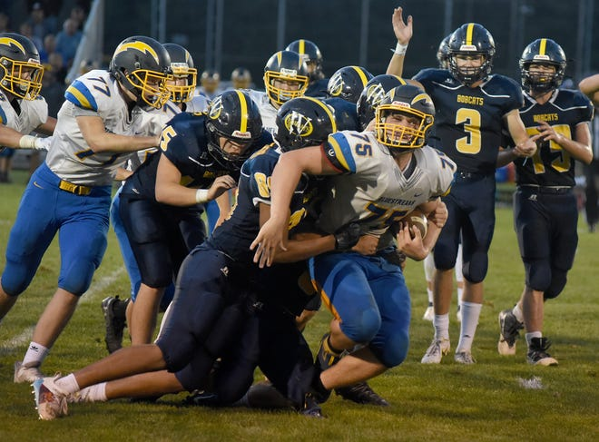 Noah Wheeler of Ida was hit hard by Whiteford on a short kick off hoping for a fumble Thursday, September 2, 2021.